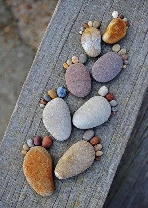 yard art:)   This would be easy and fun to do, with a hot glue gun in hand and an assortment of rocks and pebbles. The board gives a nice vintage look.
