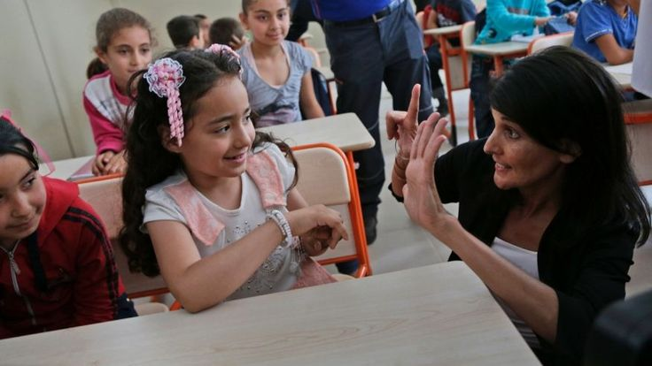 U.S. Ambassador to the U.N. Nikki Haley, right, talks with Syrian refugee children at the Sakirpasa Umran school, funded by the US government, following its opening ceremony in Adana, southern Turkey, on May 24, 2017.