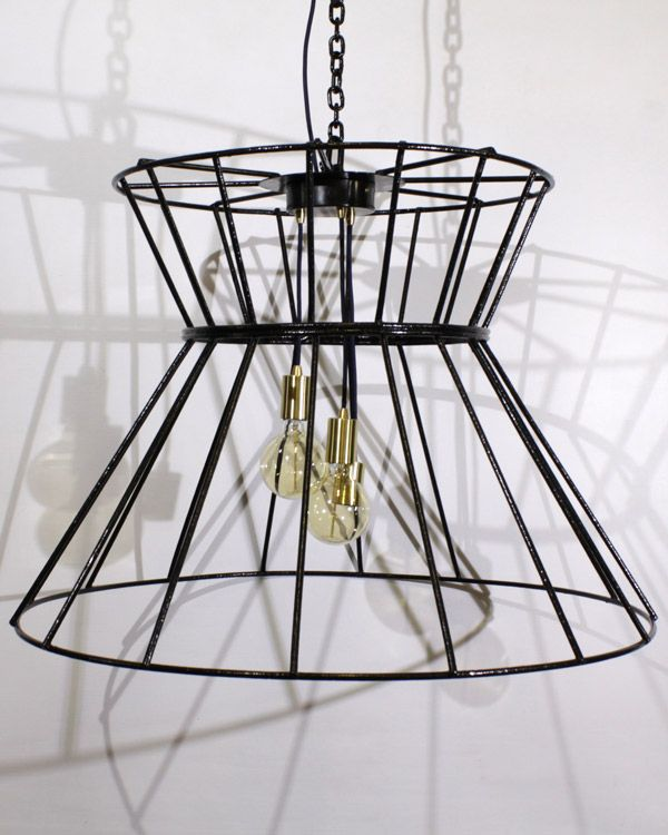 A chandelier recreated from an old metal frame.