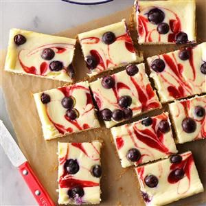 """Red, White & Blue Cheesecake Bars Recipe -I've tried """"light"""" cheesecake recipes before with mixed results. Making a few changes, I created a rich, creamy cheesecake filling that truly tastes like the real deal. —Katie Farrell, Ann Arbor, Michigan"""