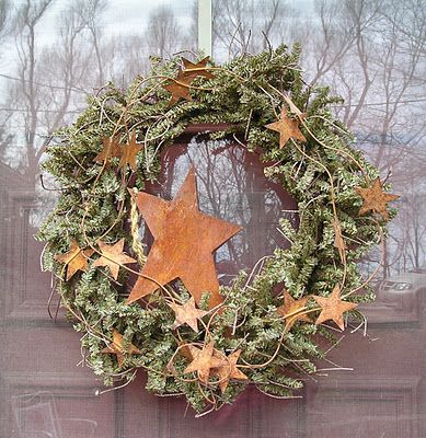 I want to make this wreath - spray the grapevine dark blue, add just a little greenery given a white dusting with spray, and add white/off white stars for summer.
