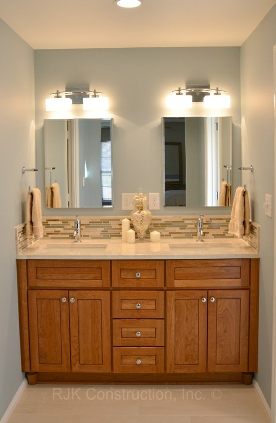 bertch bath cabinetry was designed in cherry wood with fawn stain and