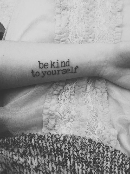 "Little forearm tattoo saying ""be kind to yourself""."