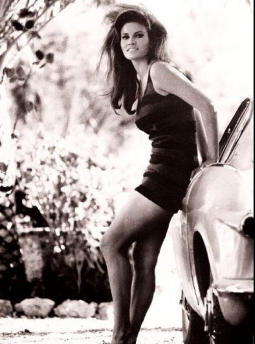 Raquel Welch with a classic Volvo 1800.