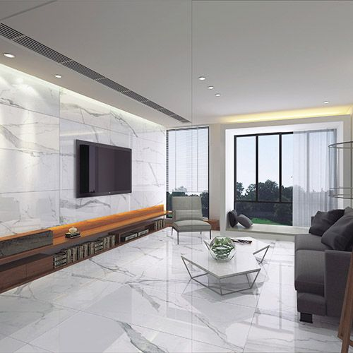 Marble will never fail to be in fashion and these stunning white Calacatta marble effect porcelain tiles are used both on the walls and floor of this stunning apartment.  #white #marble #tiles