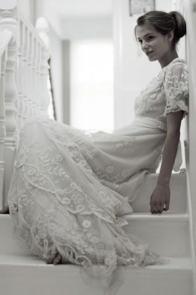 THIS LOOKS LIKE MY DRESS! Also from the 1900's, mine has scallop-shapes instead of flower-shapes. But you get the idea.