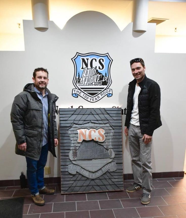 The finished slate logo hand made and hand delivered by Orion Jenkins to Chris Large.