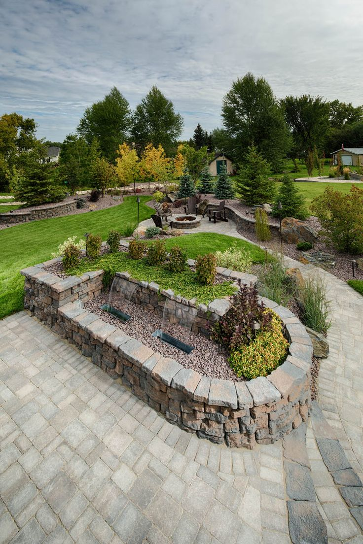 Create a backyard centrepiece with a water feature on a garden wall.