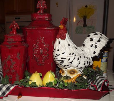 French country. Love the red canister behind the rooster. Great combination. For my friend @Pamela Culligan Culligan Culligan Baird