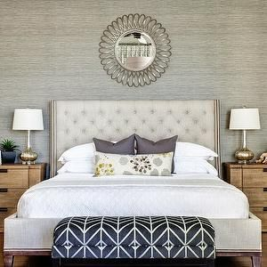 J and J Design Group - bedrooms - gray grasscloth, grasscloth wallpaper, gray grasscloth wallpaper, wallpapered accent wall, wallpapered headboard wall, linen tufted headboard, linen button tufted headboard, linen button tufted wing headboard, linen tufted wingback headboard, linen wingback headboard, wingback headboard with nailhead trim, white coverlet, white matelasse coverlet, gray pillow, gray floral pillow, oak nightstand, transitional oak nightstand, oak three drawer nightstand, gold…