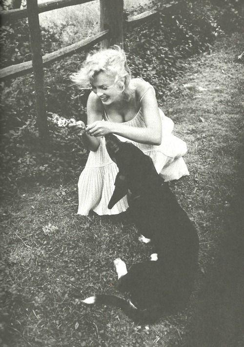 Marilyn Monroe with her dog, Hugo - 1957.