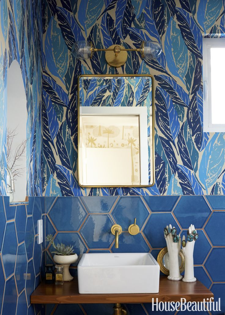 The wallpaper in the master bath is Nana, with Cosmic Desert in the bedroom, both by Blakeney for Hygge & West. The mirrored medicine cabinet is by Pottery Barn.