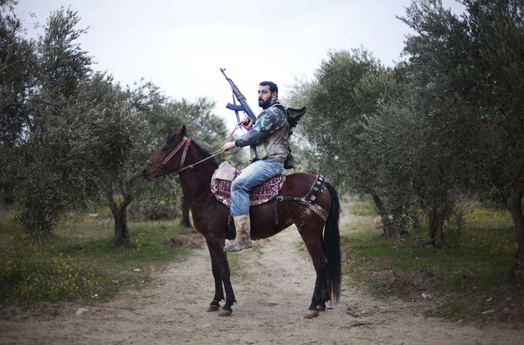 A portrait of a Free Syrian Army rebel mounted on his steed in Al-Shatouria village near the Turkish border in northwestern Syria, on March 16, 2012, a year after a revolt against President Bashar al-Assad's regime erupted. (Giorgos Moutafis/AFP/Getty Images)