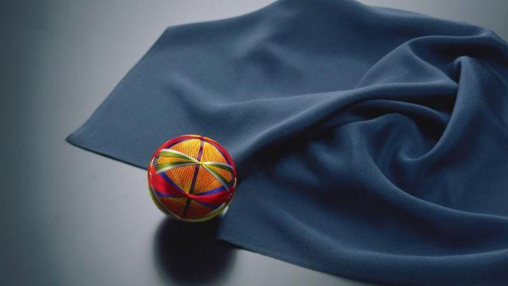 Silk Ball and Blue Fabric
