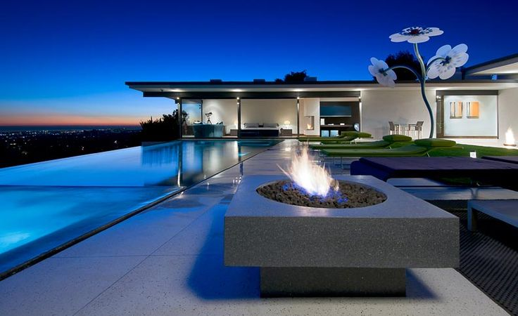 Architecture, Amazing Contemporary Private House Including Outdoor Pool With Lounge Chair And Modern Fireplace Beautified With Lighting At Night: Private House Designs with Splendid and Luxurious Contemporary Themes