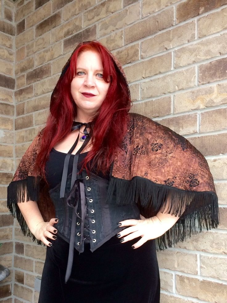 A personal favorite from my Etsy shop https://www.etsy.com/ca/listing/252062650/steampunk-hooded-fringed-capelet