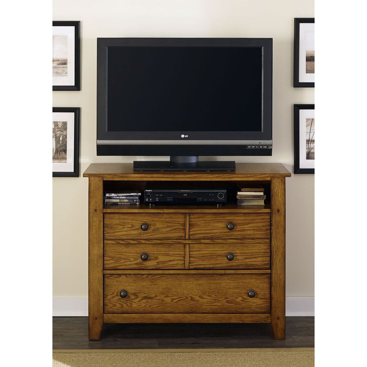 Grandpas Cabin media chest offers a distinctive rustic, cozy cottage style. Craftsman design with a warm aged oak finish over ash and oak veneers gives this beautiful furniture a casual and inviting look.