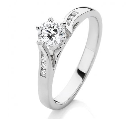 This Canadian Fire ring is a classic statement in style. It contains a Canadian Fire centre diamond weighing 0.45ct with channel set diamond shoulders that sweep around the collet. Crafted from 18ct white gold, this ring will never go out of fashion