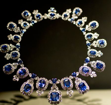 The Hall Sapphire Necklace, designed by Harry Winston, Inc., features 36 cushion-cut sapphires from Sri Lanka, totaling 195 carats, set in platinum. Their soft sky blue color is accented by 435 pear-shaped and round brilliant-cut diamonds, totaling 83.75 carats