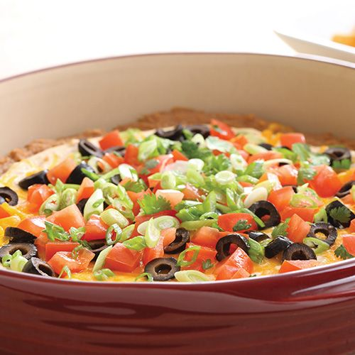 Touchdown Taco Dip - I love to make this warm dip in my Pampered Chef Round Covered Baker ($52.00) or Medium Rectangle Baker ($43.50)