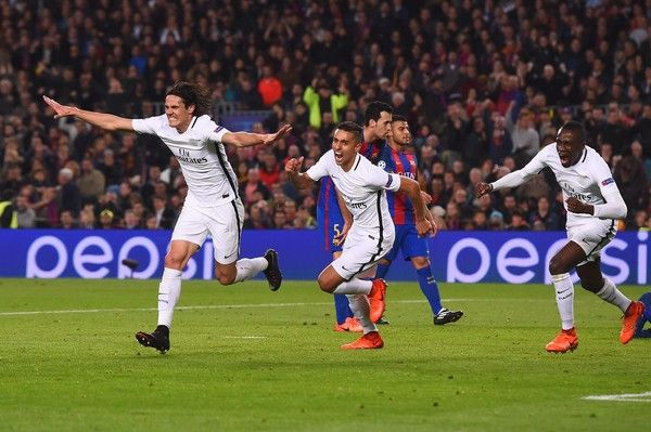 Paris Saint-Germain's Uruguayan forward Edinson Cavani (L) celebrates after scoring their first goal during the UEFA Champions League round of 16 second leg football match FC Barcelona vs Paris Saint-Germain FC at the Camp Nou stadium in Barcelona on March 8, 2017. / AFP PHOTO / Josep Lago