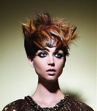 A short brown straight coloured multi-tonal messy spikey hairstyle by Joico    Visit us for #hairstyles and #hair advice   www.ukhairdressers.com