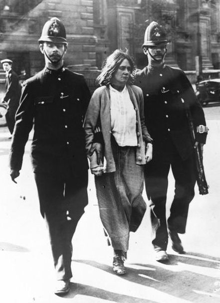 A suffragette arrested in the street by two police officers in London in 1914 en.wikipedia.org/...