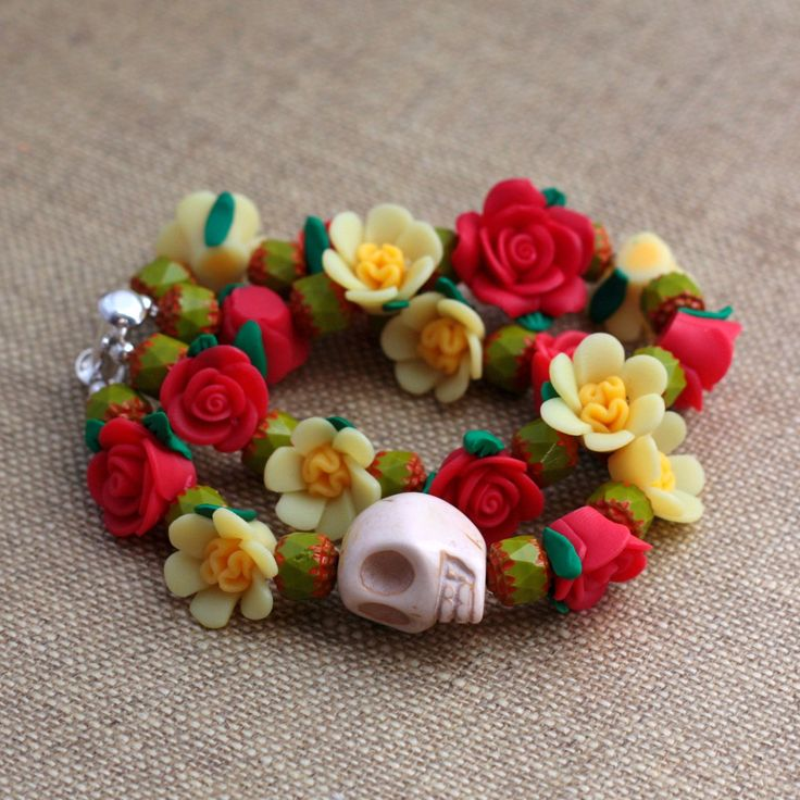 Day of the Dead Double Strand Flower and Skull Bracelet - Red and Yellow. $36.00, via Etsy.