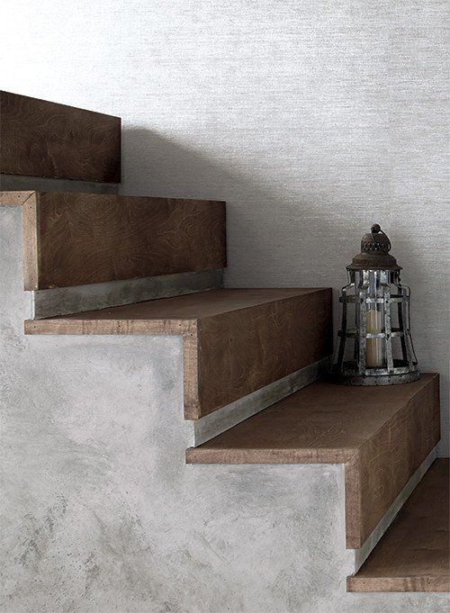 Like fine woven silk shantung, this wall covering has minimal texture with just enough horizontal striations to add interest when struck by light. In addition, there are flecks of color and thread-lik