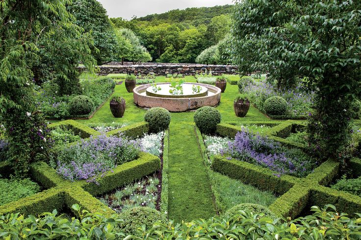 Anne Bass's medicinal garden in South Kent, Connecticut is home to many varieties of aromatic plants, set in a grid of dwarf boxwoods and fences entwined with espaliered pear and apple trees.