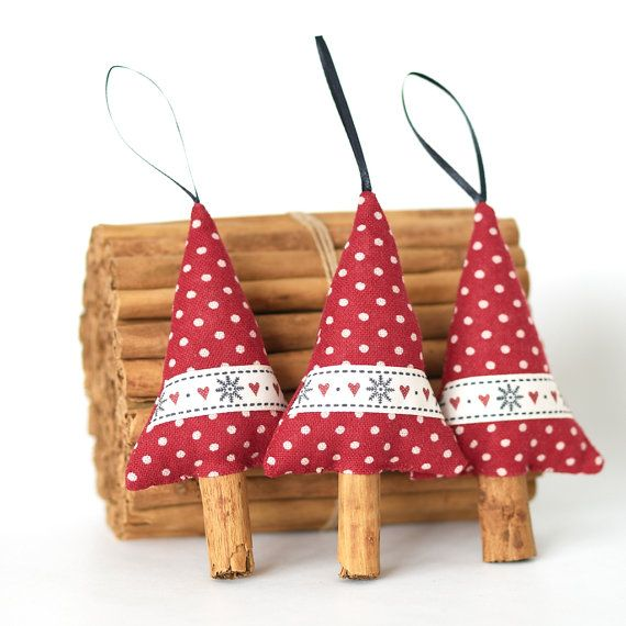 Fragrant cinnamon wood Christmas tree decorations with real cinnamon stick tree trunks. A charming way to bring the look of a traditional handmade Christmas into your home. The trees are made from a rustic red polka dot fabric and decorated with snowflake and heart grosgrain ribbon. They are stuffed with fibre fill and have a black ribbon loop at the top for hanging. The trunks are sticks of top quality culinary grade cinnamon with a wonderful scent ... they do smell just like Christmas…