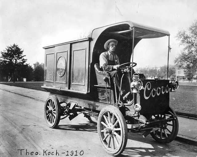 Great old photo of Theo Koch driving a Coors beer delivery wagon.  1910