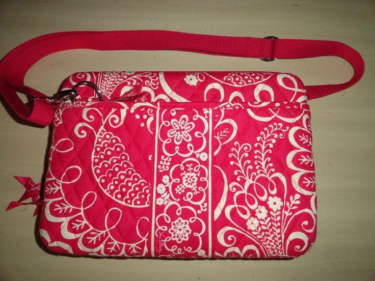 """For sale is a retired MINI LAPTOP CASE in the TWIRLY BIRD PINK pattern from VERA BRADLEY. It measures approximately 11 1/2 x 8 x 2 inches with 48"""" removable, adjustable shoulder strap. This hard case has a double-zipper which allows it to open wide for easy use. The interior holds mini laptops, netbooks, and iPads up to 11"""" (with 2 padded bars for repositioning and a custom fit)."""