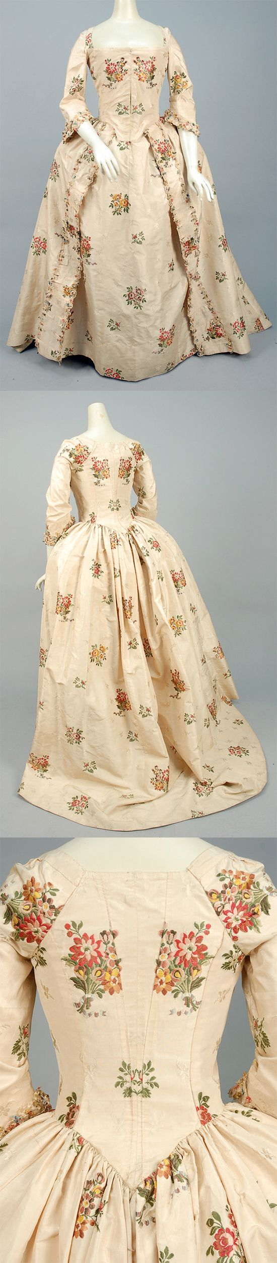 SILK BROCADE ROBE a L'ANGLAISE, CANADIAN, 1750 - 1775. Ivory silk brocaded with small tone on tone flowers and larger polychrome floral clusters, semi boned bodice with square-cut neckline and elbow length sleeve, pleated cuff decorated with fancy cord and polychrome tassels, trained open skirt with cord-trimmed furbelows, matching petticoat, bodice lined in cotton and linen. | Whitaker Auctions