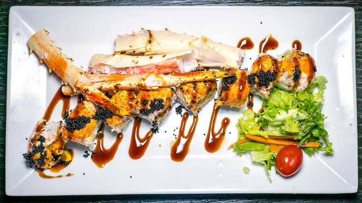 Born in the USA (King crab White Sesame seeds Cucumber and Avocado topped with Seared Spicy Snow Crab Black Tobiko Eel sauce and Orange slice) from Ten Sushi @tensushiseattle in #seattle - #imenehunes #food #yum #delicious #japanesefood #sushi #kingcrab #sesameseeds #cucumber #avocado #blacktobiko #eelsauce #orangeslice #tensushi