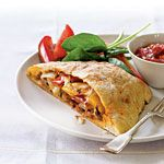 17 meals that freeze well  |  Grilled Pepper, Onion, and Sausage Calzones Recipe & more
