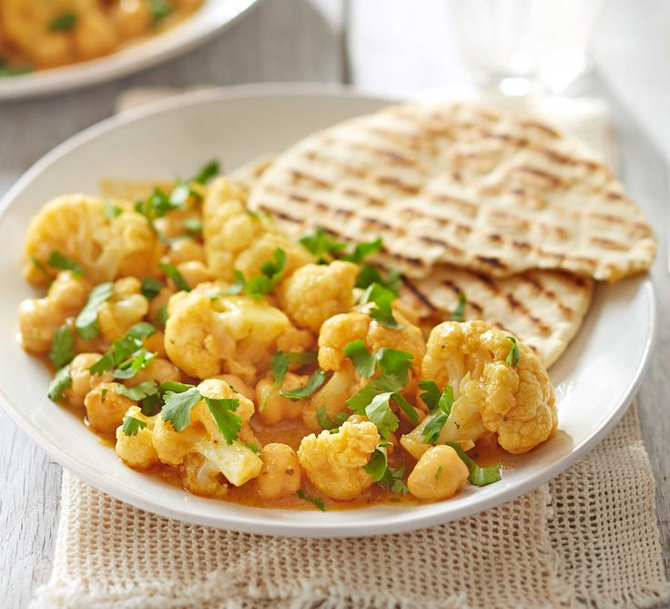An easy vegetarian curry that can be cooked in one pan with a rich and creamy sauce - serve with simple, homemade flatbreads