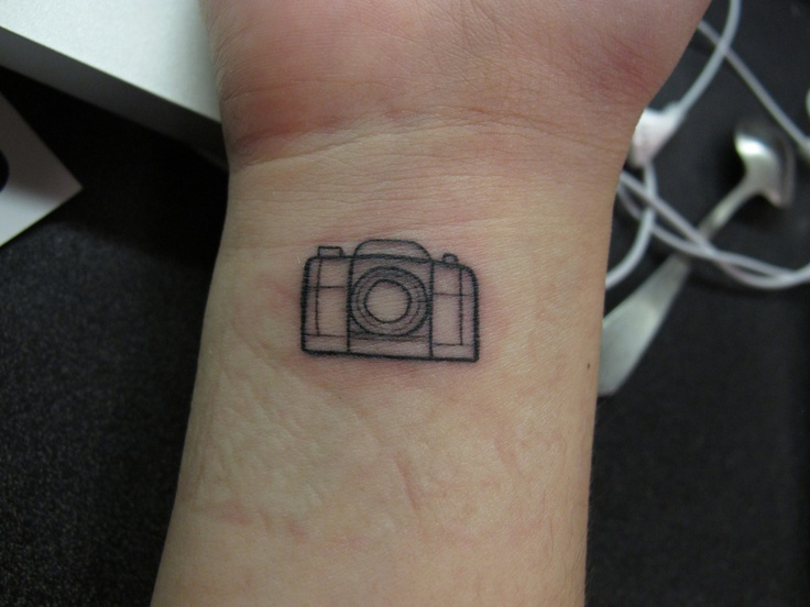 my little camera right after i took the bandage off :) my first tat done at Adrenaline vancity by Mike Dawkins. photography will always be a my biggest passion in life, and will always be a part of me :)