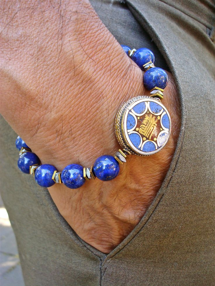 Men's Spiritual Kalachakra Om Bracelet with Semi Precious Lapis Lazuli, Hematies, Tibetan Silver and Bronze Bead with Lapis and Coral Inlay by tocijewelry on Etsy
