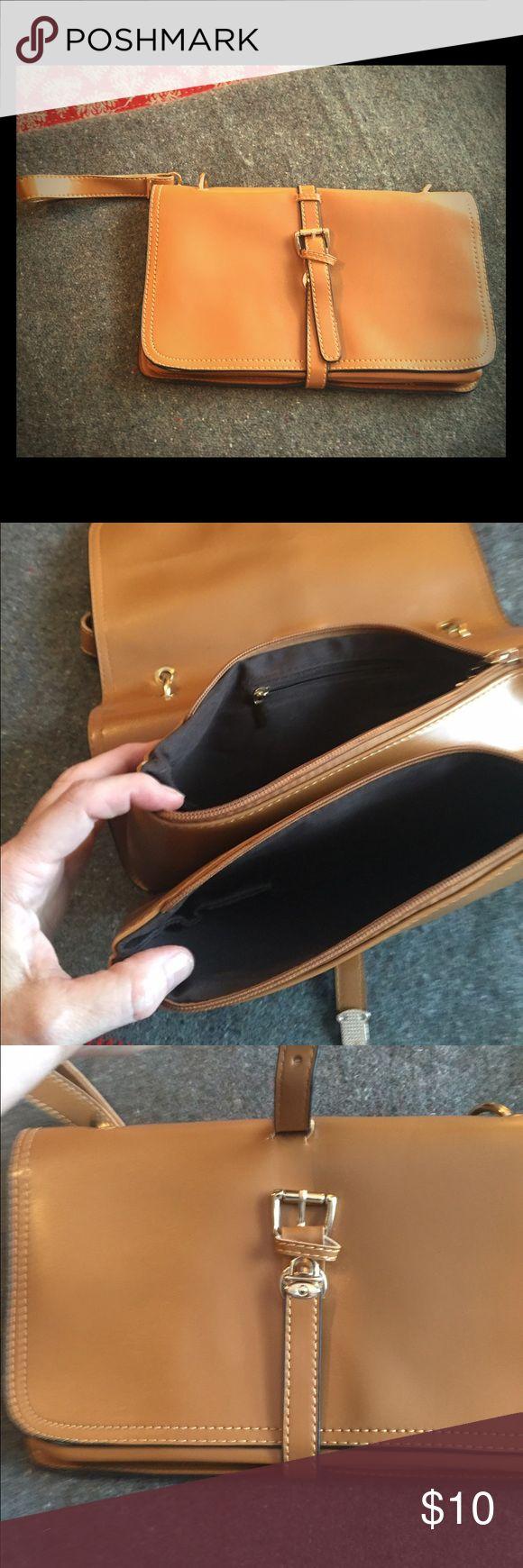 Cute faux  leather camel clutch purse nwot Cute faux  leather camel clutch purse nwot  smoke free home very cute!!! Bags Clutches & Wristlets