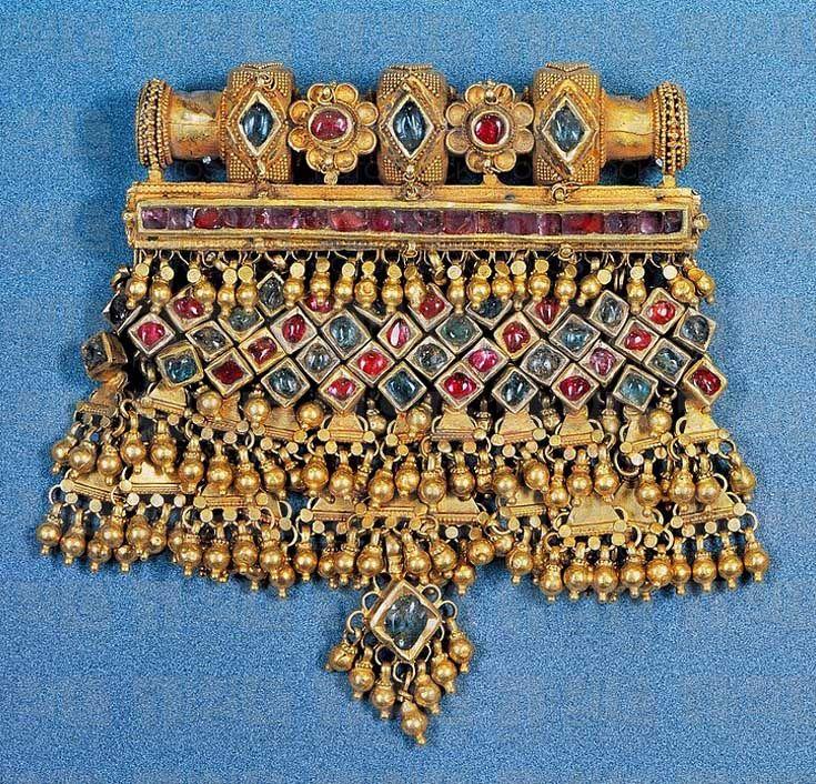 India - Rajasthan | Marwari women's pendant in gold and precious stones. | Private Collection. Image ©De Agostini / A. Dagli Orti