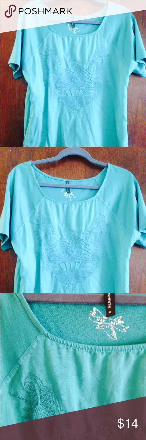"""*From Paris* green (teal) embroidered blouse! I bought this gorgeous understated embroidered top at a boutique called NafNaf in Paris. It is a chain there but is rare to find here!! Worn only once. In mint condition. Beautiful teal color! Cute tucked in front or free flowing. (5'6"""", 135 lbs: fits well, but loose) Naf Naf Tops Tees - Short Sleeve"""