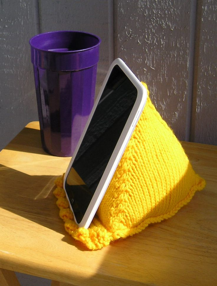 Knitting Pattern for Tablet Stand - This pyramid pillow stand is great for propping up your ereader, smartphone, or tablet so you can knit or cook or relax hands free.