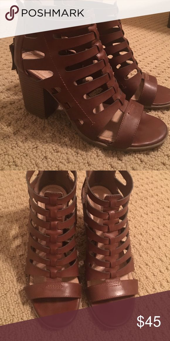 Heeled sandal Cut out trendy sandal. This is the trend right now. Deep gorgeous brown. Pair with rompers, shorts, overalls. Size 8 could fit 8.5 indigo Shoes Sandals