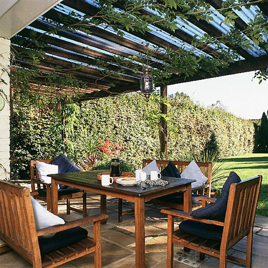 Garden dining area - this would look great with outdoor fabric softening the under side of the roof.