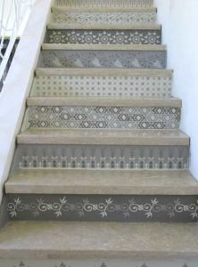 each step stencilled differently. Subtle colors on concrete steps out front.