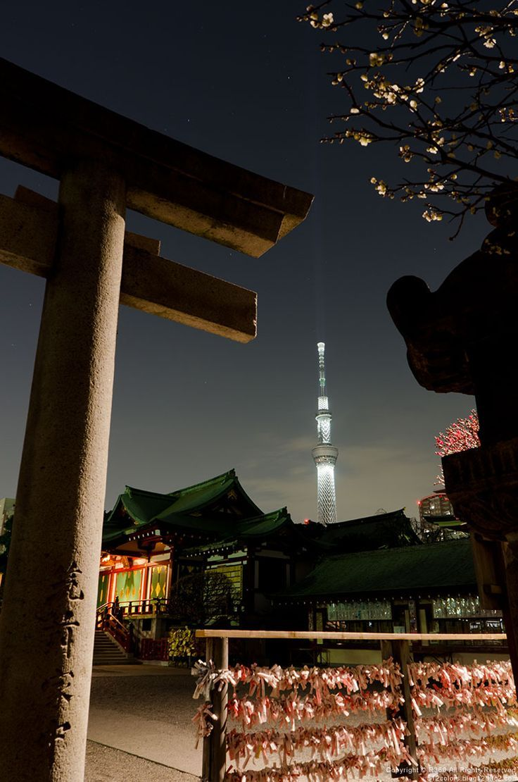 "Traditional old Shinto shrine with Tokyo's 2080-foot-high ""Skytree"" in the background"