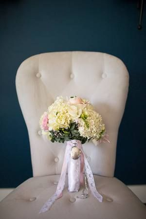 Brides Bouquet featuring a locket with special photos inside.