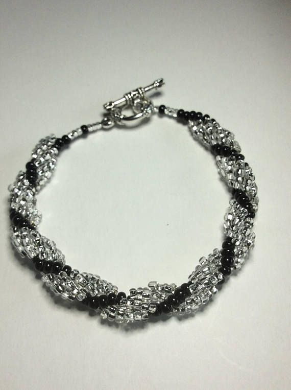 This bracelet is just so pretty. It is made with seed beads only. It's spiral shape gives brilliance. Simple yet stunning, great as a little something for that special someone.