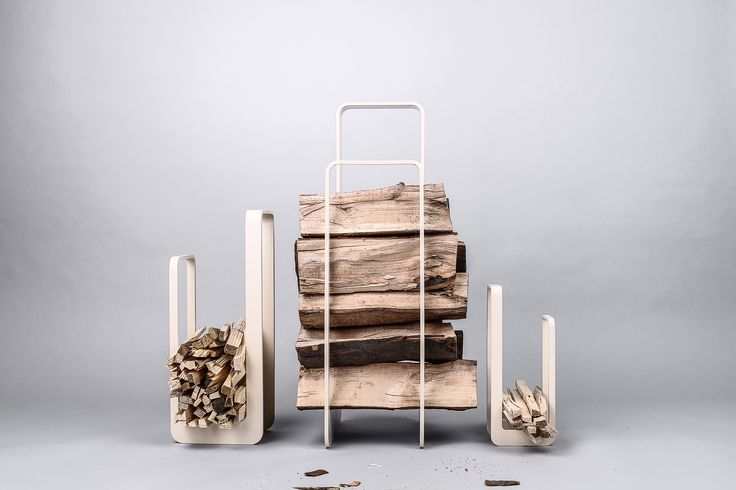 Elegant firewood rack with or without fireplace tools from designers & craftsmans duo Uhrecki. Matt Ivory powder coating.